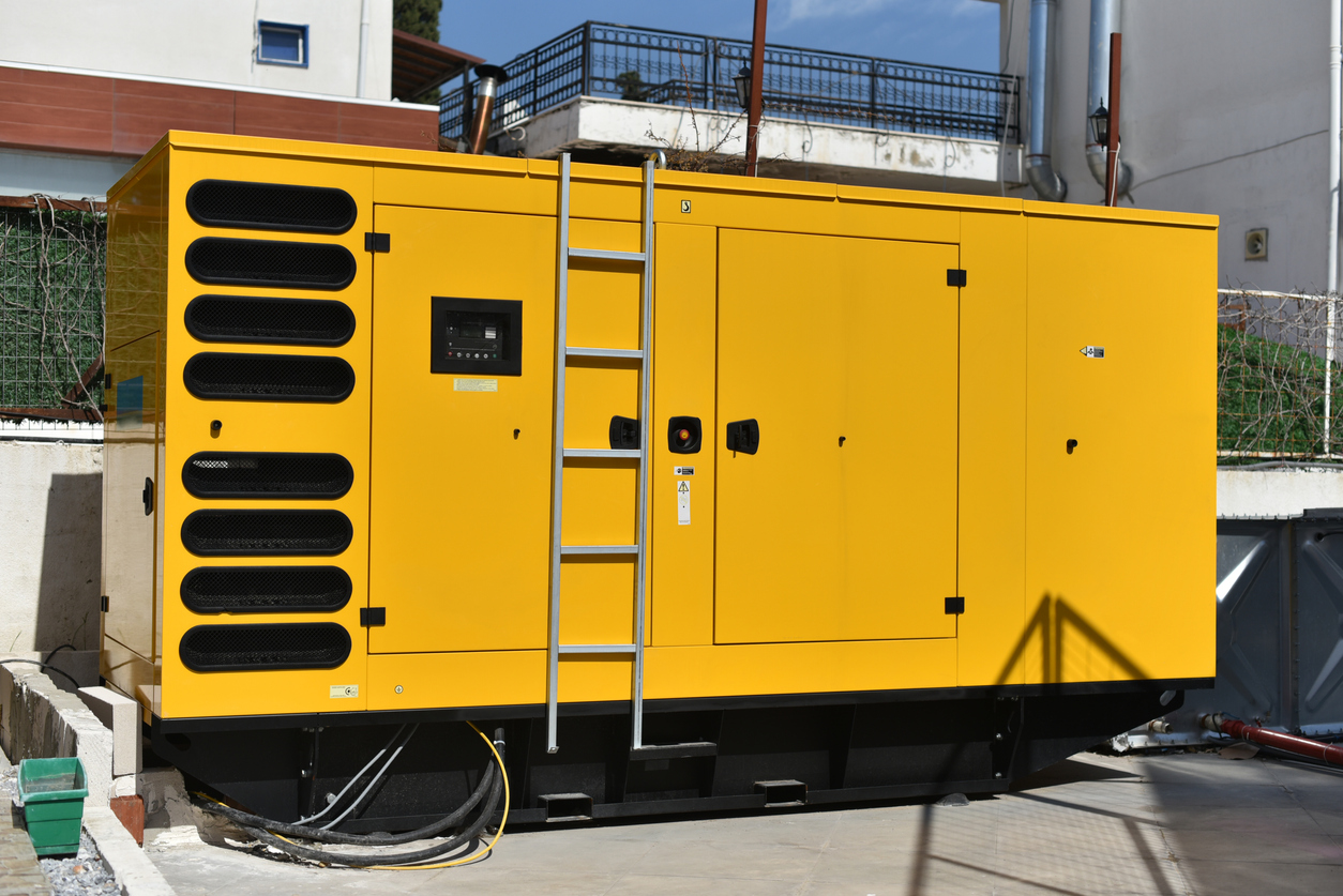 commercial generator sitting outside a building