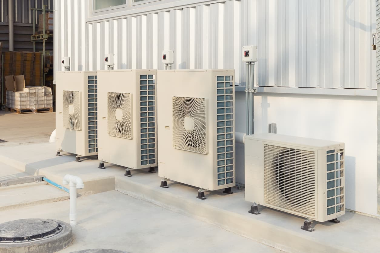 a high-efficiency commercial HVAC system sitting outside a commercial building